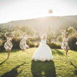 Garden villa wedding Italy. Bride's launch of the bouquet in Villa Baroncino lush garden.
