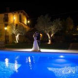 Exclusive weddings villa Italy, beautiful photo at Pool area at night time with inside the water coloured lighting effect. Outdoor Wedding Villa Italy. Pool Wedding ideas
