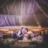 Marquee Wedding Ideas. Bride and groom toast.