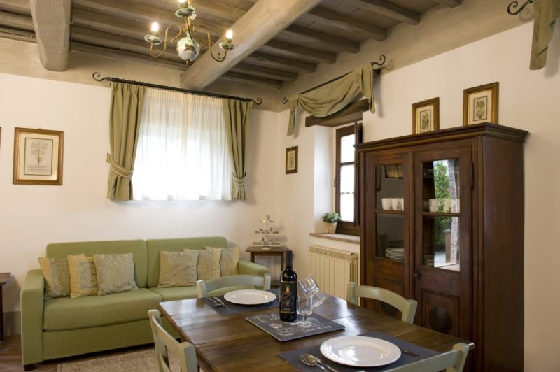 Weddings tuscany. A detail of the living area and set up table for lunch in the kitchen area in Suite Villa 5.