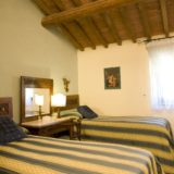 wedding apartment villas. A detail of the 2 single beds bedroom in Villa 8