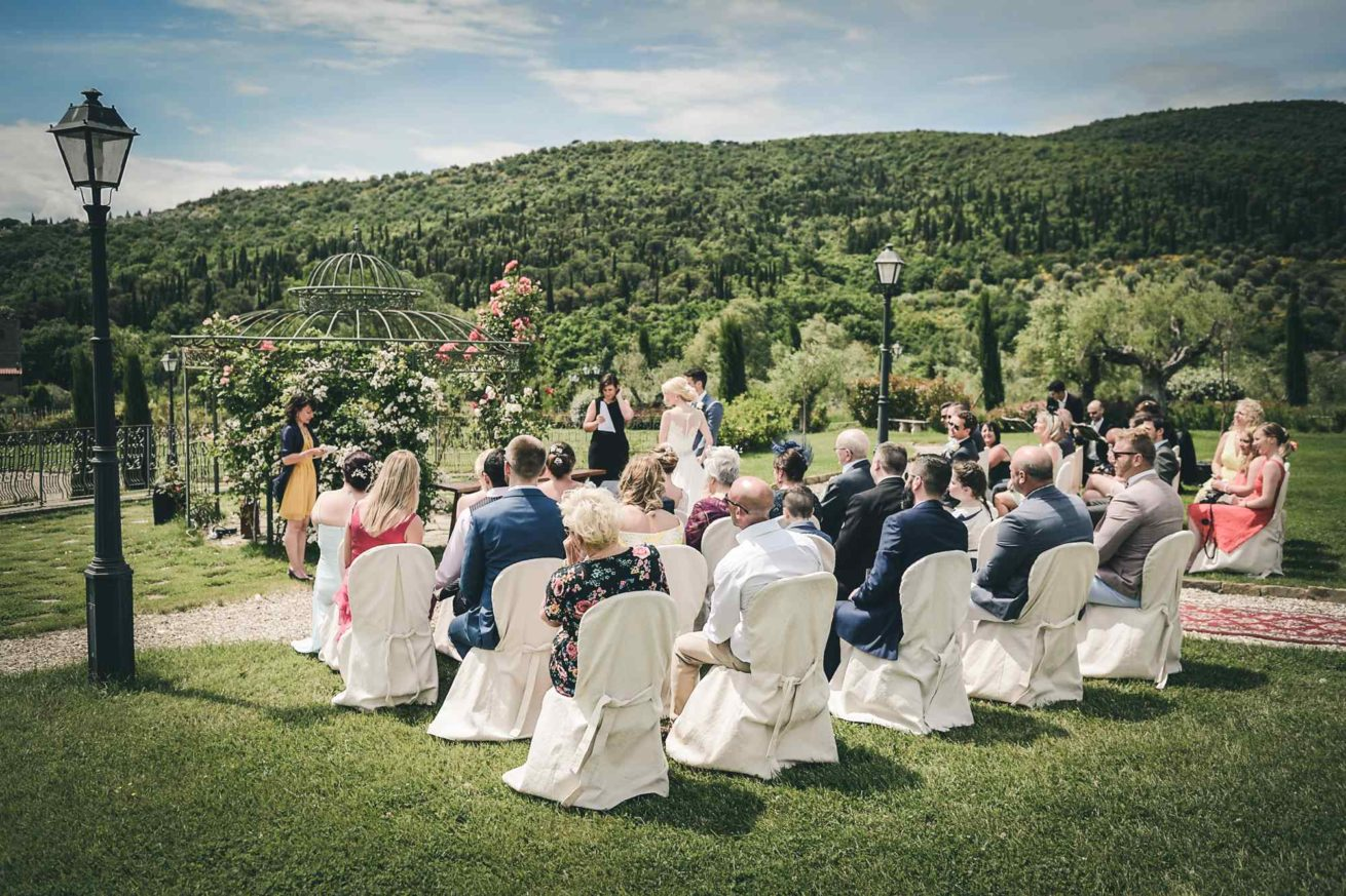 Garden villa wedding Italy. Setting for the outdoor ceremony in the villa garden.