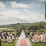 Garden villa wedding Italy. A moment of the legally binding ceremony celebrated in the lush garden.
